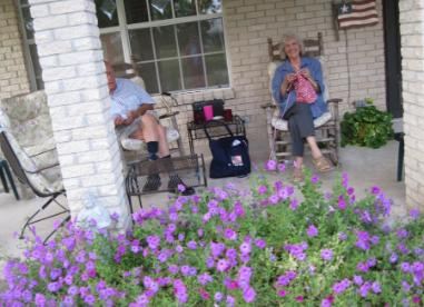 And my favorite... a summer afternoon with Dear Heart and my knitting with the Laura Bush petunias in bloom.